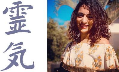 Portrait of Seena Chand with reiki symbols alongside her.